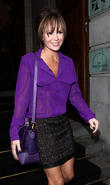 Amanda Holden leaves her hotel