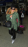 Rita Ora arrives back in London