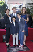 Simon Baker, wife Rebecca Rigg and family