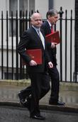 William Hague and Defence Secretary Philip Hammond (R)