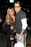Adrienne Maloof and Sean Stewart leaving a party