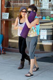 Vanessa Hudgens hides her face as she leaves a yoga class in Studio City with a friend