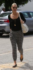 Molly Sims, with wet hair, arrives at her doctor's office in Beverly Hills wearing harem pants