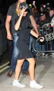 Rihanna in good spirits as she returns to her London hotel