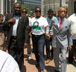 Al Sharpton, Benjamin Crump and Sabrina Fulton