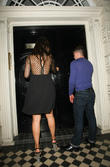 Kelly Brook arrives home with a male friend after partying at Mahiki nightclub