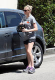 Kirsten Dunst going in to the gym