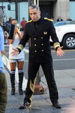 Robbie Williams dancing around Hollywood Blvd