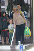 Amy Poehler picks up son Abel from school...