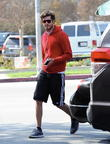 Newly married Adam Brody is all smiles after seeing a chiropractor