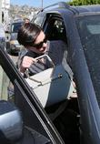 Anne Hathaway departs a store with husband Adam Shulman