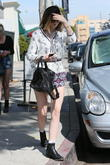 Kylie Jenner, highlights, sunglasses, black boots, ankle boots, black handbag, leather, jewelry, iphone, apple, cell phone