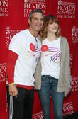 Andy Cohen and Emma Stone