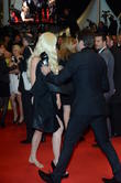 Topless woman on the Cannes red carpet escorted off., Cannes Film Festival