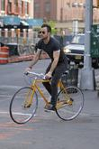 Justin Theroux riding his bike