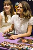 Celebs signing autographs