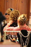 Jane Fonda tries on accessories at a Beverly Hills boutique