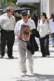 Mel Brooks leaves lunch with a few gifts from a fan