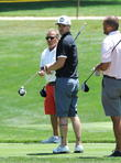 Justin Timberlake plays golf while his wife Jessica Biel watches