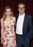 Gillian Jacobs and Gary Oldman