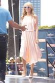 Paris Hilton seen on Extra TV Show at Universal City Walk.