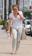 Hilary Duff spotted in Beverly Hills wearing torn sweatpants