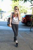 Emma Roberts exits the Nine Zero One salon