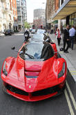 Super cars parked outside BVLGARI Hotel