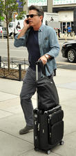 Peter Gallagher leaving a hotel in New York City