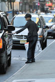 A camera-shy Meg Ryan gets into an SUV in Soho