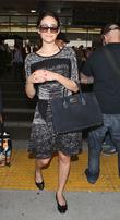 Emmy Rossum arrives at Los Angeles International Airport (LAX)