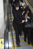 Khloe Kardashian arrives at Los Angeles International Airport (LAX) looking cozy in a hooded black catsuit