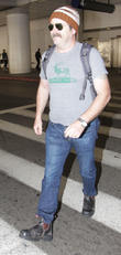 Nick Offerman arrives at Los Angeles International Airport