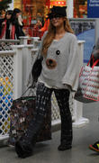 Paris Hilton leaves her London hotel and heads to King's Cross St Pancras International station