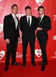 Jamie Cook, Matt Helders and Alex Turner