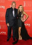 Steve Tisch and Guest