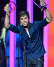 Enrique Iglesias Selling Charity Shirt Featuring Bloodied Image