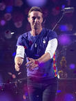 Chris Martin Serenades Couple At New York Show