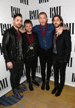 Imagine Dragons, Daniel Platzman, Ben Mckee and Dan Reynolds