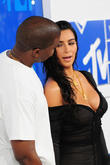 Kim Kardashian Steps Out In Sheer Plunging Dress For Kanye West Concert