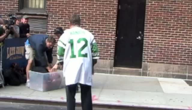 Alec Baldwin and Joe Namath playing football