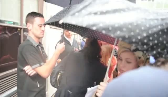 Tulisa Contostvalos Meets Fans In The Pouring Rain