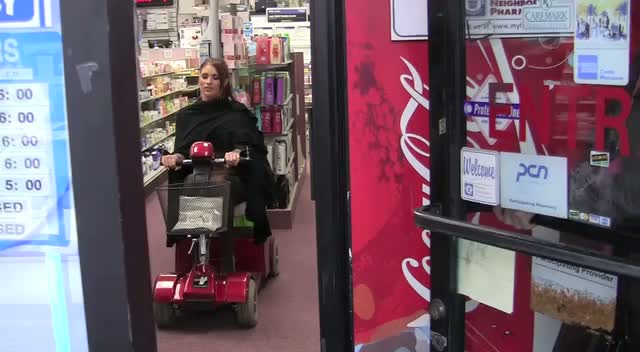 Amy Childs Plays On A Scooter Inside Drugstore