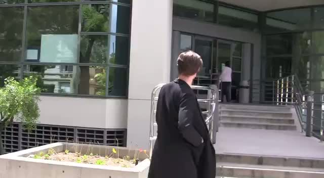 Matt Smith walking and entering an office building in Beverly Hills