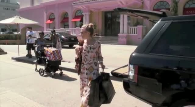 Rachel Zoe and her son leaving Barneys of New York in Beverly Hills
