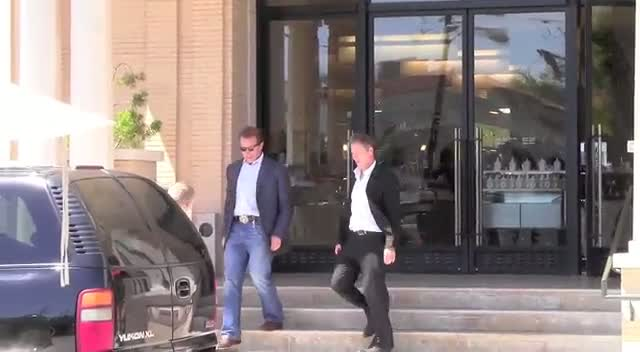 Arnold Schwarzenegger leaving Barneys New York in Beverly Hills