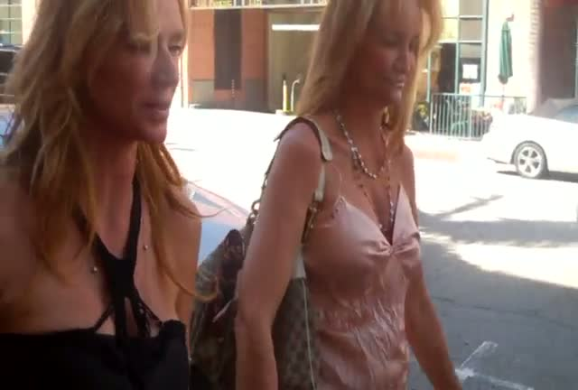 Former Playboy model Kimberley Conrad leaving Beverly Hills Nail Design with a friend
