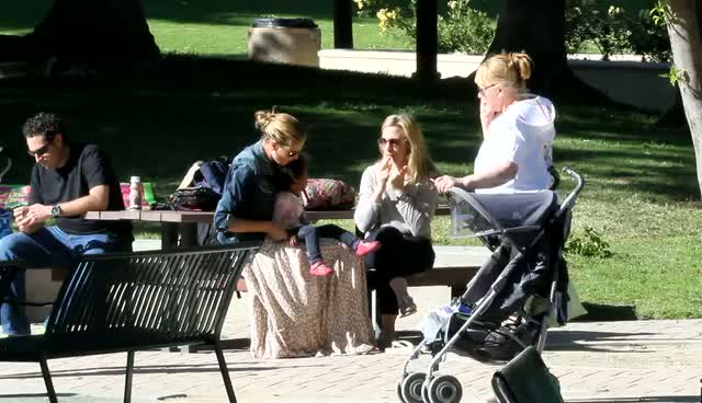 Heidi Klum wearing a light brown maxi dress and denim jacket, spends time with family and friends in a park - Part 1