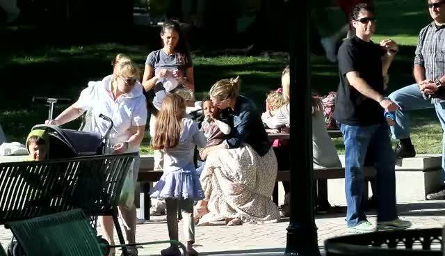 Heidi Klum wearing a light brown maxi dress and denim jacket, spends time with family and friends in a park - Part 2