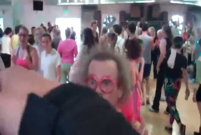 The flamboyant fitness guru Richard Simmons arrives at his aerobics dance studio dressed in a red feathered leotard and wearing some red glasses shaped as lips